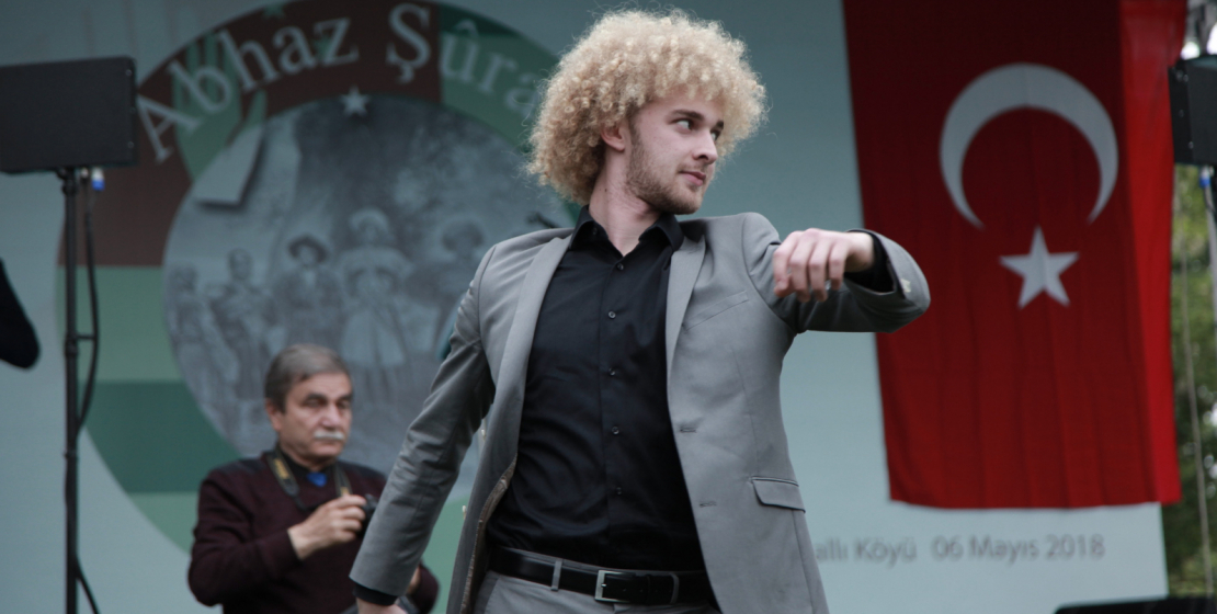 A young man performs the folk Abkhaz dance.