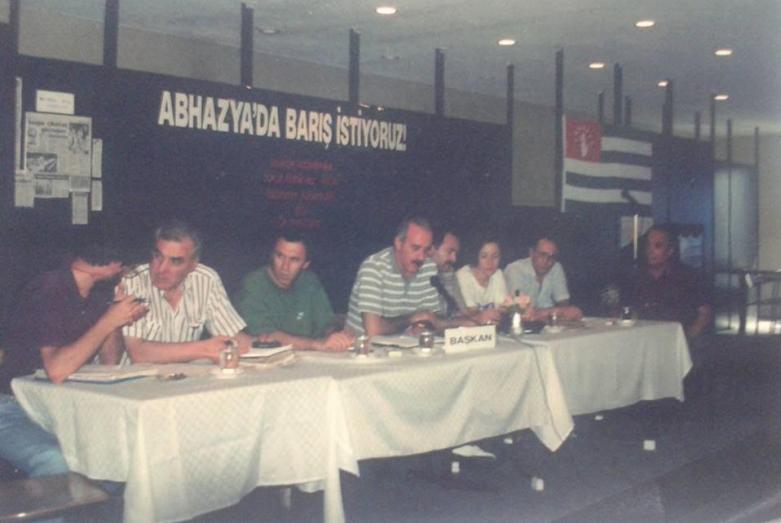 Sesai Papba, Irfan Argun, Erkhan Hapayu, Atai Atsushba, Cengiz Gogua, Gunduz Gechba, Ilhan Kuadzba as part of the delegates of the First Congress of the Abkhaz-Abaza people, Lykhny, October 1992