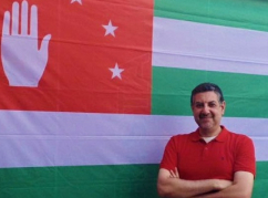 Mohammed Abaza with the Abkhaz flag