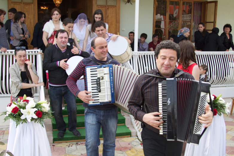 Traditional coming of the bride to the Abkhaz instrumental music in the wedding tent for guests of the festival