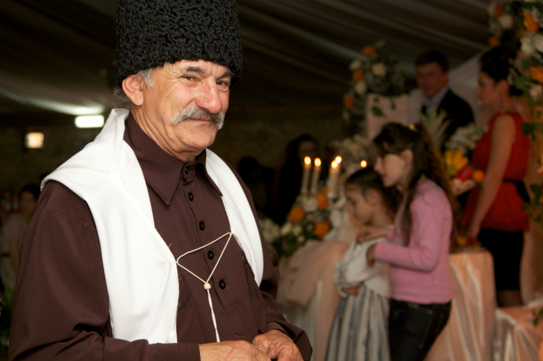 Guest in the national Abkhaz clothes at the wedding