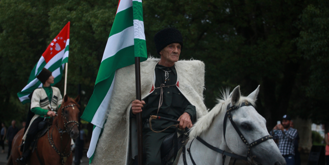 Horse riders were in the heart of attention. They took the State Flag of Abkhazia across the Makhajirs Promenade