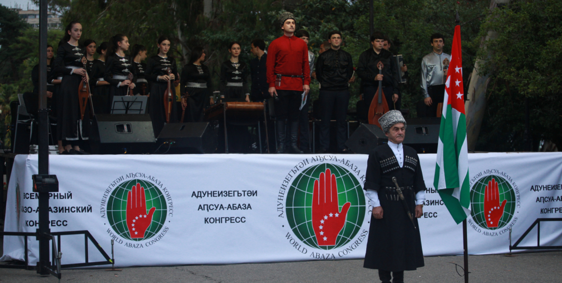 In the foreground: Member of the Supreme Council of the World Abaza Congress Nuri Kvarchia, who solemnly took the State Flag at the beginning of the holiday
