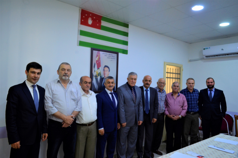 "From left to right in the photo: Inar Gitsba, Mohammed Yagan, Aziz Abaza (Mkhtse), Mussa Ekzekov, Hasan Abaza (Chichba), Nabil Abida, Karam Gechba, Hani Abaza (Bakyz), Mohammed Abaza (Chichba) and Inver Alshundba at the meeting in ""Diwan Abaza"" in Jordan"