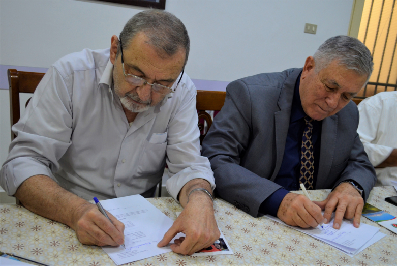 "Head of ""Diwan Abaza"" Hasan Abaza (Chichba) and Mohammed Yagan fill out an application for membership in the WAC"