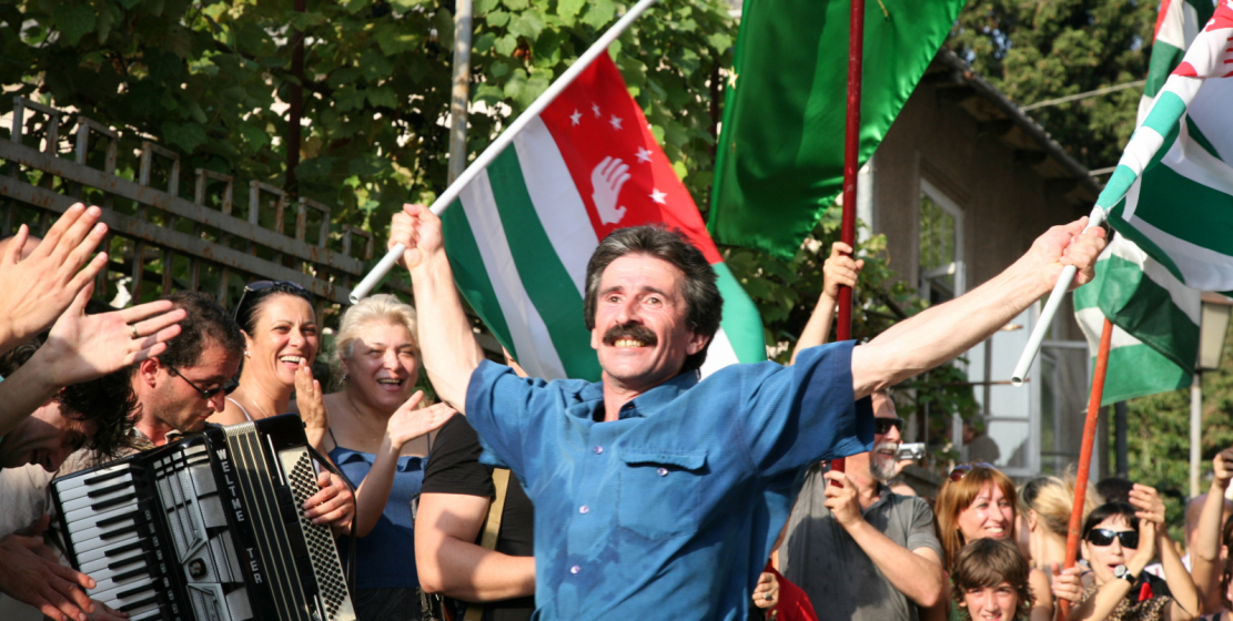 "People gathered in a circle and danced Abkhaz dances.  In the photo: Honored Artist of Abkhazia Givi Tskoliya.  ""I will remember this day forever.  We (the people of Abkhazia) have been coming to this for so long ... "", recalls Tskoliya on August 26, 2008"