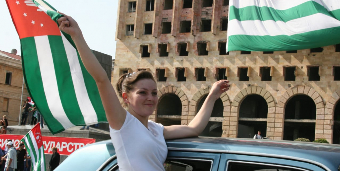 Drivers were playing  Abkhaz songs, Abkhaz flags fluttered from car windows