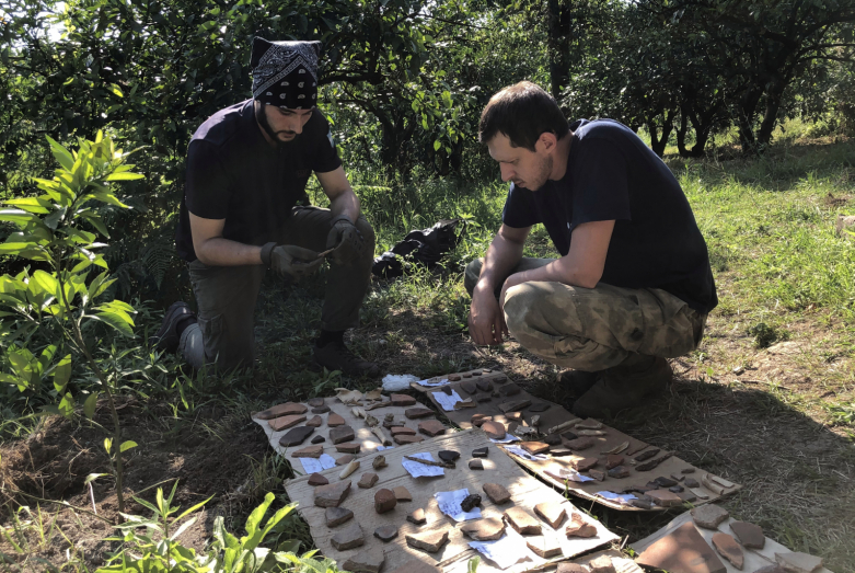 Archaeologists study the found artifacts