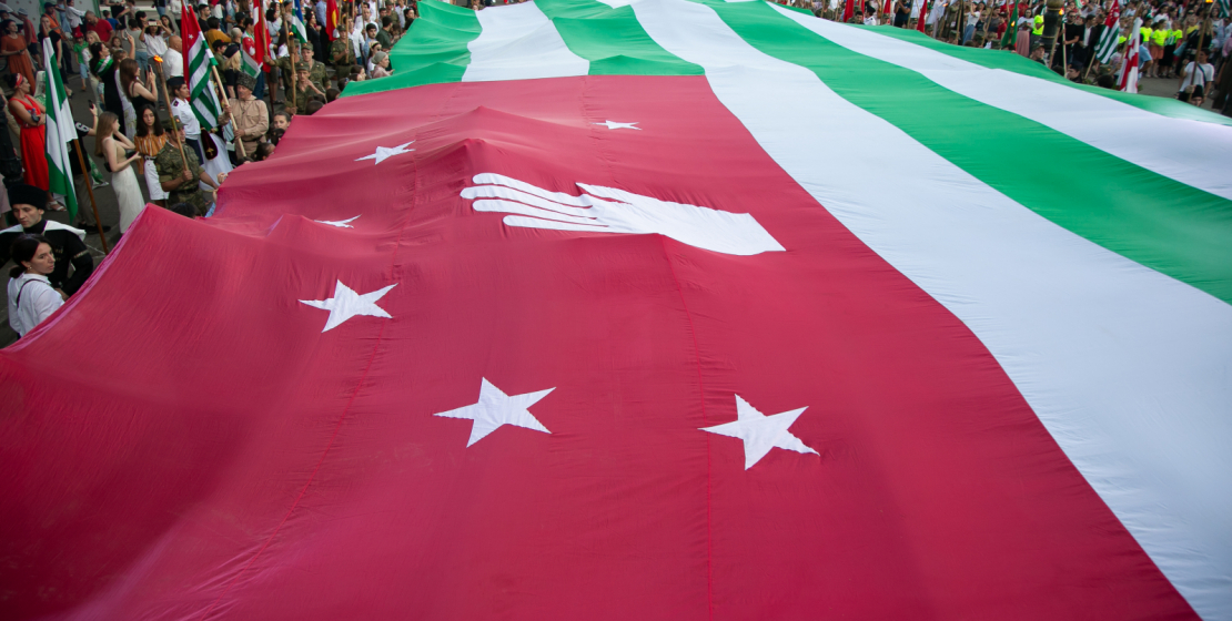 It has become an annual tradition to carry a huge - 10 by 20 meters - canvas of the State Flag of Abkhazia along the Makhajirs Embankment.