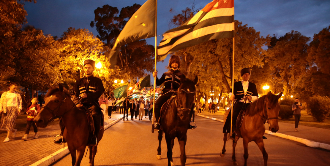 The column was led by riders in national costumes, followed by torchbearers.