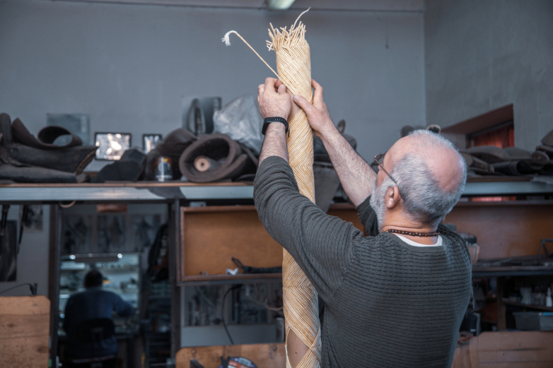 Artist Batal Japua creates ashamaka - a traditional Abkhazian candle.