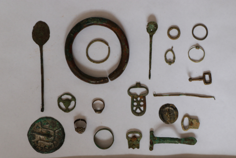 Elements of women's jewelry and insignia, Bronze age. Fragment of a battle ax of the middle ages. Found in the vicinity of the Elburgan village by the head of the Bibarkt Ethnographic Museum, Mukhamed Tukov